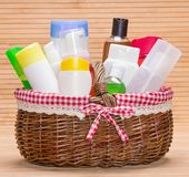 Wicker basket filled with different beauty products Royalty Free Stock Photo