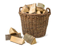 Wicker basket filled with firewood Royalty Free Stock Photography