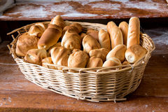 Wicker basket filled with fresh assorted rolls Stock Image