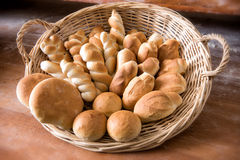 Wicker basket filled with freshly baked bread Stock Image