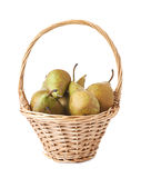 Wicker basket filled with pears isolated Stock Image