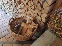 Wicker basket of firewood on the stairs stock photos