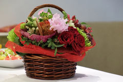 Wicker basket flowers. Royalty Free Stock Images
