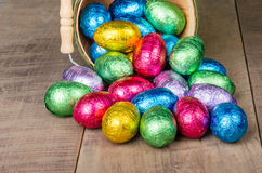Wicker basket of foil Easter eggs Royalty Free Stock Photo