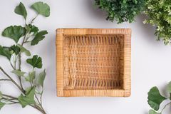 Wicker Basket with Foliage Flat Lay Top View. A Wicker Basket with Foliage Flat Lay Top View Stock Photography