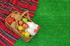 Wicker Basket With Food And Drink On the Picnic  Blanket Royalty Free Stock Photo