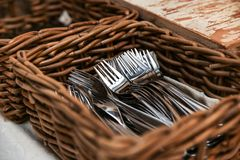 Wicker basket with forks in the restaurant. stock photo