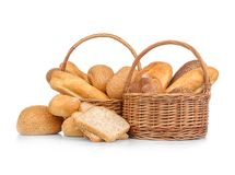 Wicker basket with fresh bread. On white background Royalty Free Stock Photos