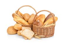 Wicker basket with fresh bread. On white background royalty free stock photo