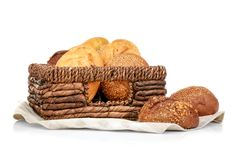Wicker basket with fresh bread. On white background Stock Photo