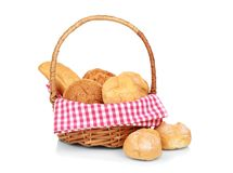 Wicker basket with fresh bread. On white background Royalty Free Stock Images
