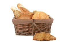 Wicker basket with fresh bread. On white background Stock Photos
