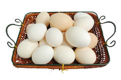 Wicker basket with fresh eggs Stock Photo