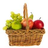 Wicker basket fresh fruit. Wicker basket full with fresh fruit isolated over white background Stock Photography