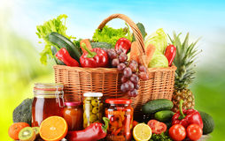Wicker basket with fresh organic vegetables. Balanced diet Stock Photos