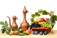 Wicker basket and fruit Stock Image