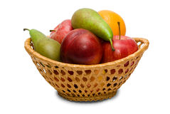 Wicker basket with fruit. Isolated on white background Stock Images