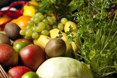 Wicker basket with fruit and vegetables. A large wicker basket full of assorted fruit and vegetables Royalty Free Stock Photos