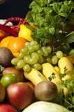 Wicker basket with fruit and vegetables. A large wicker basket full of assorted fruit and vegetables Stock Photo