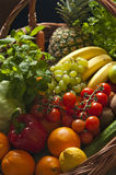 Wicker basket with fruit and vegetables. A large wicker basket full of assorted fruit and vegetables Stock Photography