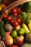 Wicker basket with fruit and vegetables. A large wicker basket full of assorted fruit and vegetables Royalty Free Stock Photo