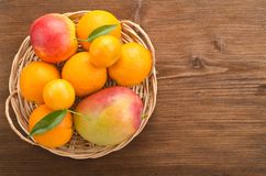 Wicker basket with fruits Stock Photo