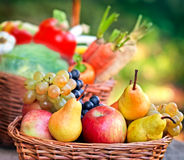 Wicker basket with fruits Stock Photos