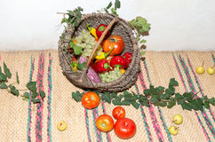 Wicker basket with fruits and vegetables. Stock Photo