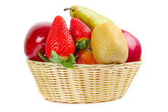 Wicker basket with fruits Stock Image