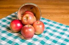 WIcker basket of Fuji apples Stock Image