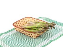 Wicker basket full with asparagus. Stock Photo