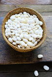 Wicker basket full of beans Royalty Free Stock Photo