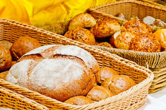 Wicker basket full of bread and rolls Royalty Free Stock Images