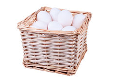 Wicker basket full of  chicken eggs. Isolated Royalty Free Stock Photo