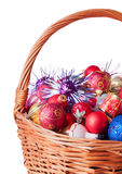 Wicker Basket full of Christmas Baubles Stock Photography