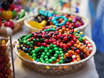 Wicker basket full of color beads Stock Photos