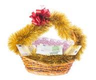 Wicker basket full of euro bills. Stock Image