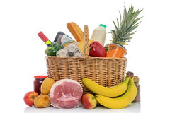 Wicker basket full of food groceries isolated Royalty Free Stock Photography