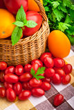 Wicker basket full of fresh tomatoes Stock Photos