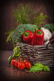 Wicker basket full of fresh veggies Stock Photo