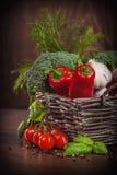 Wicker basket full of fresh veggies Stock Photo