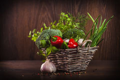 Wicker basket full of fresh veggies Royalty Free Stock Image