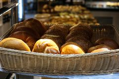 A wicker basket full of freshly baked pastry items royalty free stock photography