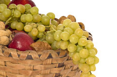 Wicker basket full of fruits Stock Photo