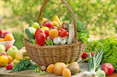Wicker basket is full with fruits and vegetables. Wicker basket is full with fresh organic fruits and vegetables stock photography