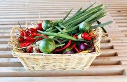 Wicker basket full of Garden Produce. Wicker basket full of fresh garden produce on a gardeners bench royalty free stock photo