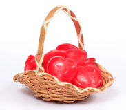 Wicker basket full of heart shape candy Royalty Free Stock Images