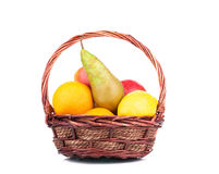 Wicker basket full of juicy fruits. Royalty Free Stock Photos