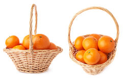 Wicker basket full of multiple ripe fresh juicy tangerines, composition isolated over the white background Stock Images