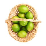 Wicker basket full of multiple ripe limes Royalty Free Stock Photo